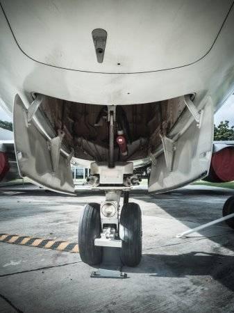 depositphotos_60230209-stock-photo-front-landing-wheel-aircraft.jpg